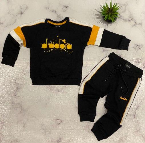 חליפת פוטר שחור/צהוב diadora בנות - 2-10 שנים