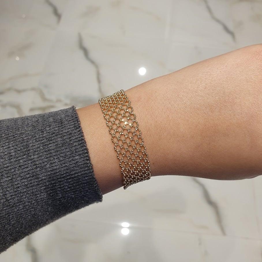 צמיד כדורי סרוג זהב לאישה (בינוני)