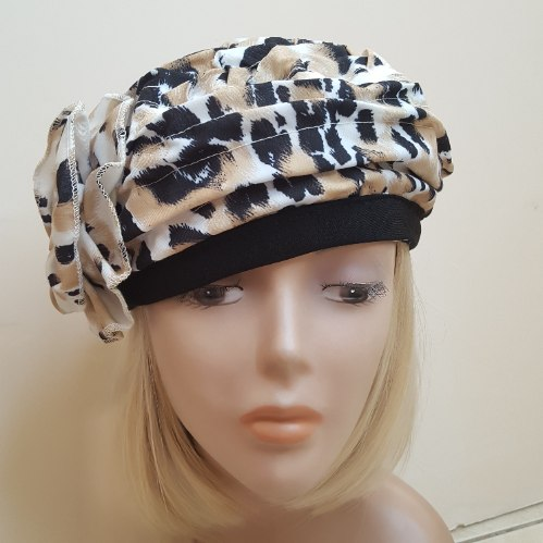 כובע מעוצב לנשים - מנומר שחור וכתום