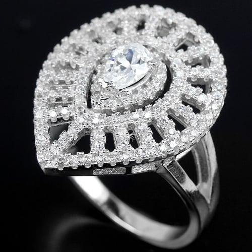 טבעת כסף משובצת טופז לבן וזרקונים RG6071