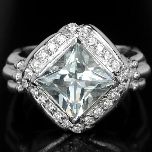 טבעת כסף משובצת טופז לבן וזרקונים RG7078