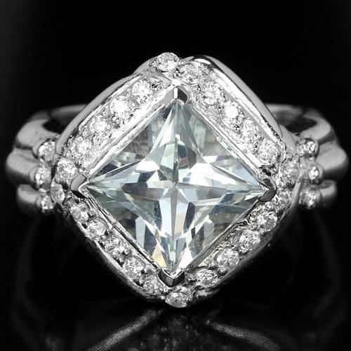 טבעת כסף משובצת זרקון מרכזי גדול וזרקונים RG7078