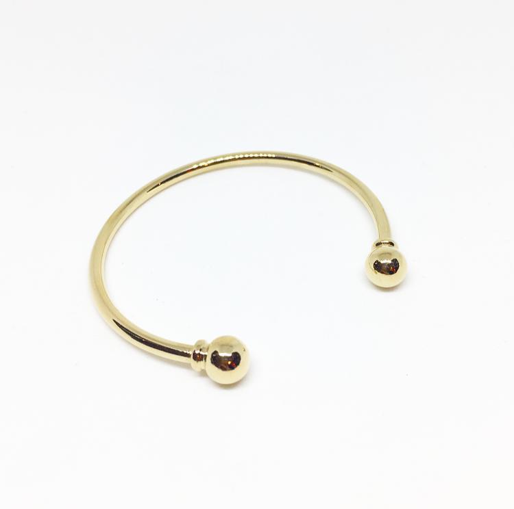 צמיד טומי עבה זהב