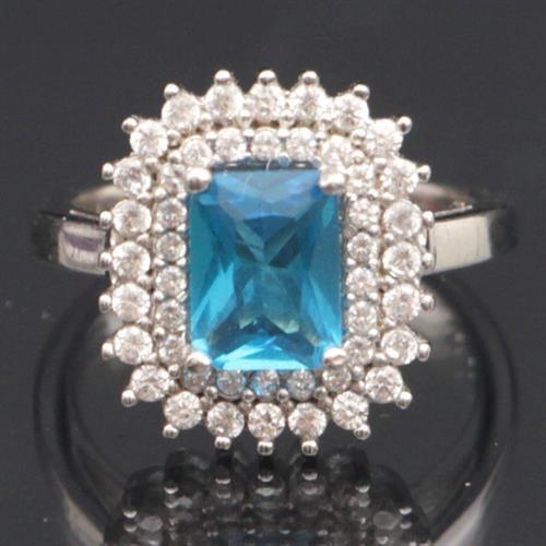 טבעת כסף משובצת טופז כחול וזרקונים RG7489