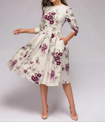 שמלת שבת לבנה פרחונית עם כיסים