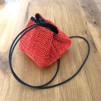 תיק צד יפני בצבע כתום ואדום מבד