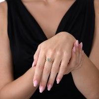 טבעת זהב צהוב 18 קרט משובצת אקוומרין נועה טריפ noa tripp