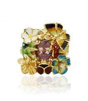 טבעת זהב מלאת נוכחות לאישה עם זרקון סגול