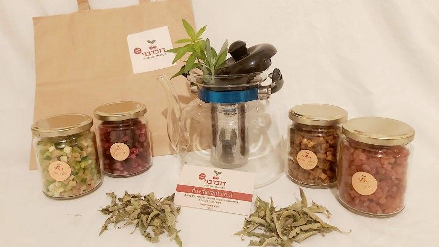 מארז תה מפנק- קומקום זכוכית חסין אש + 4 מארזי חליטות תה
