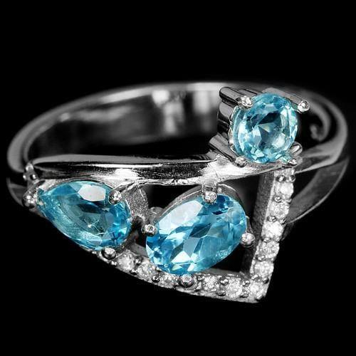 טבעת מכסף משובצת אבני טופז כחולה וזרקונים  RG5664| תכשיטי כסף 925 | טבעות כסף