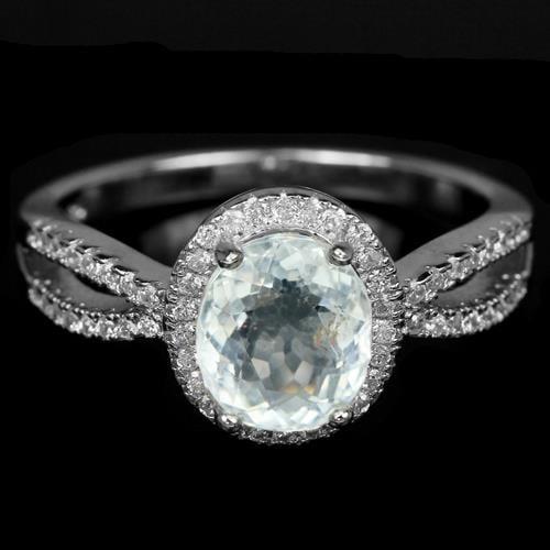 טבעת כסף משובצת טופז לבן וזרקונים RG1160