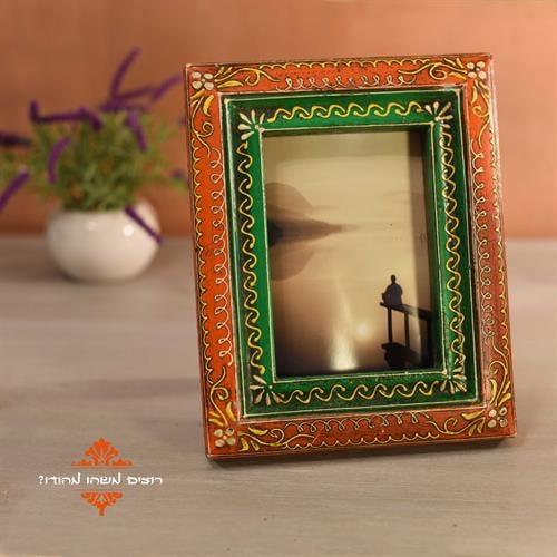 מסגרת לתמונה מעץ מעוטרת