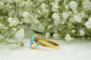 טבעת אופל כחול בחיתוך מרקיזה בזהב 14 קאראט