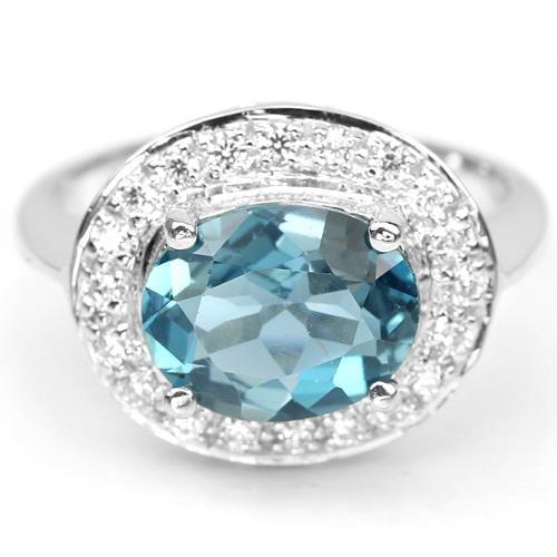 טבעת כסף משובצת טופז כחול וזרקונים RG1251