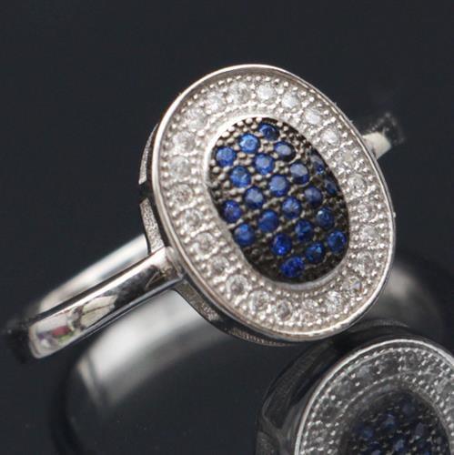 טבעת כסף משובצת זרקונים וטופז כחול RG7031