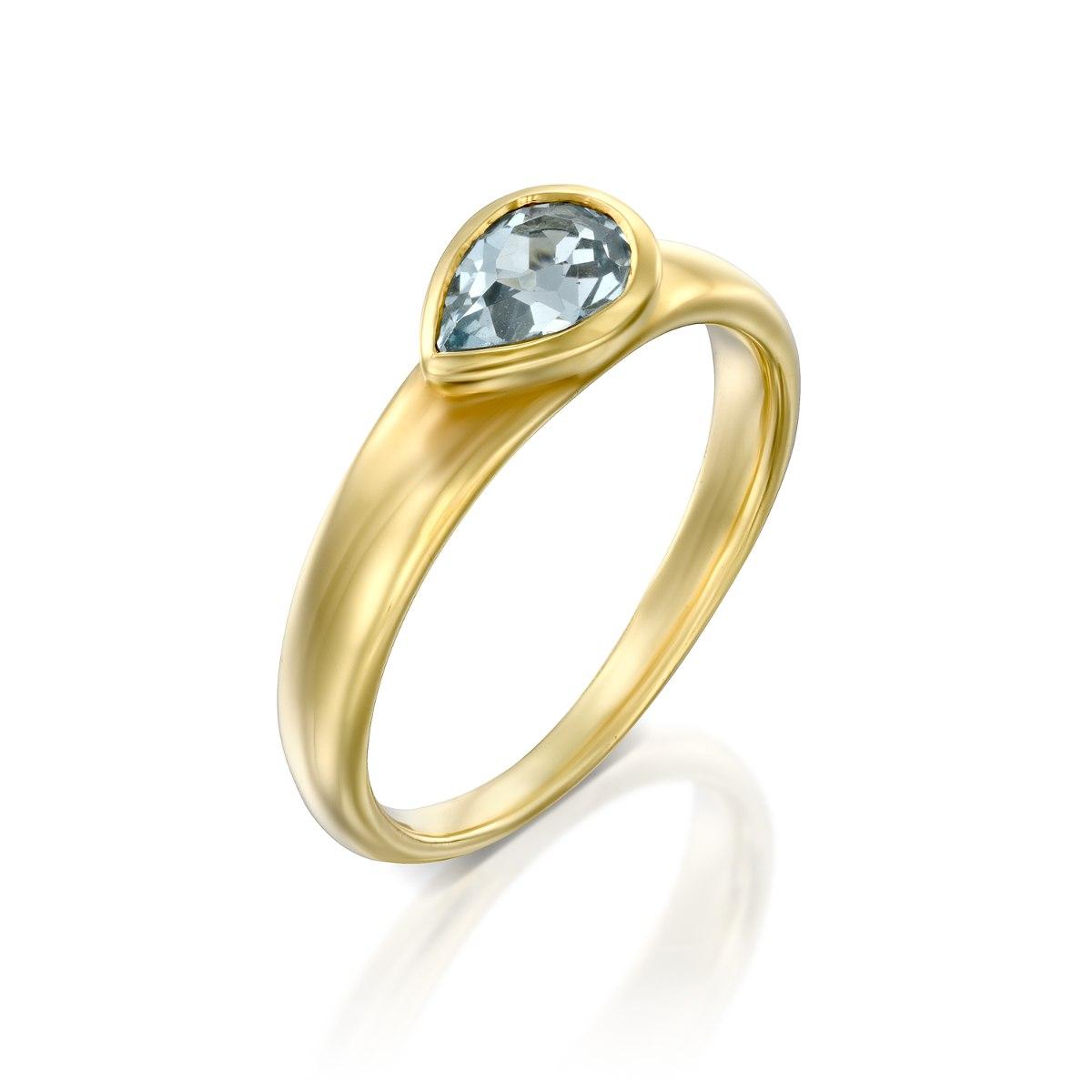 טבעת זהב 14 קרט משובצת בלוטופז בצורת טיפה נועה טריפ noa tripp