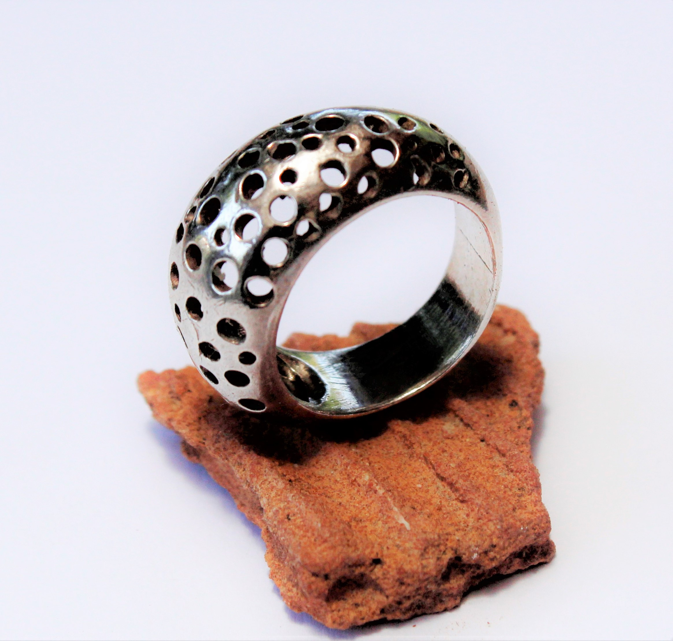 Handmade silver ring decorated with delicate cutouts around