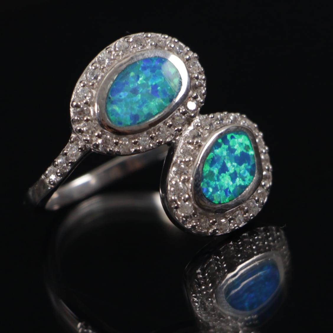 טבעת משובצת 2 אופלים וזרקונים RG6223