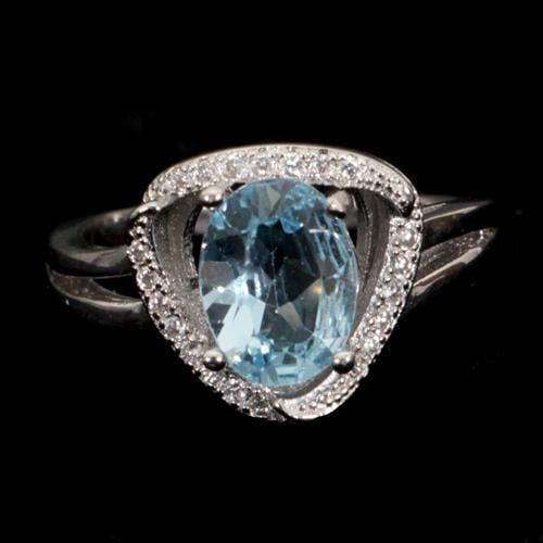 טבעת כסף משובצת טופז כחול וזרקונים RG4009