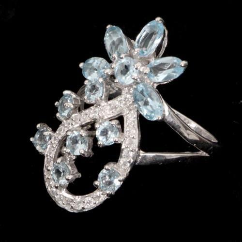 טבעת כסף משובצת טופז כחול וזרקונים RG4008