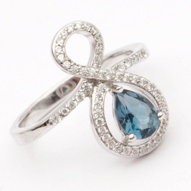 טבעת כסף משובצת טופז כחול וזרקונים RG7780