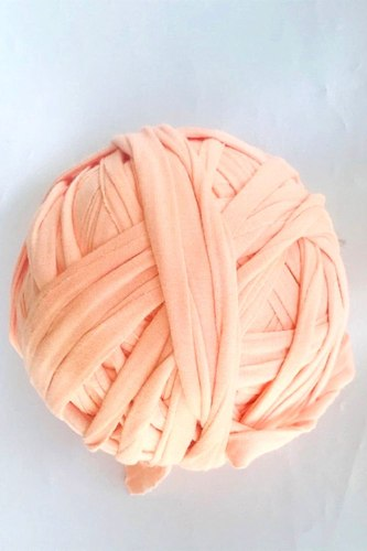 עודפי ייצור של חוטי טריקו פרוסים לסריגה צבע אפרסק בייבי