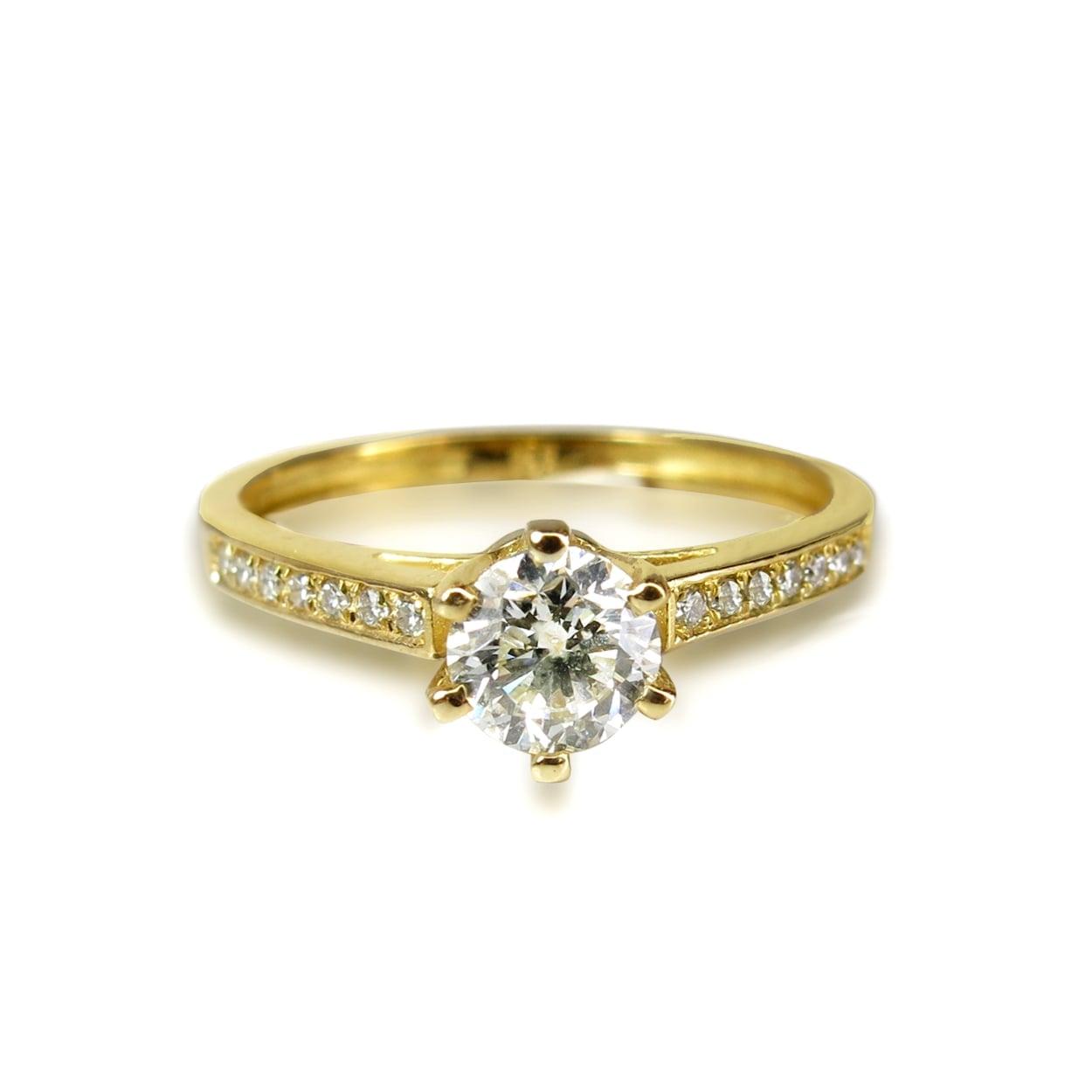 טבעת יהלומים עשירה ונוצצת 0.38 קראט בזהב 14 קאראט