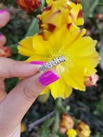 טבעת איטרניטי פרחים משובצת יהלומים 0.30 קראט בזהב 14 קרט