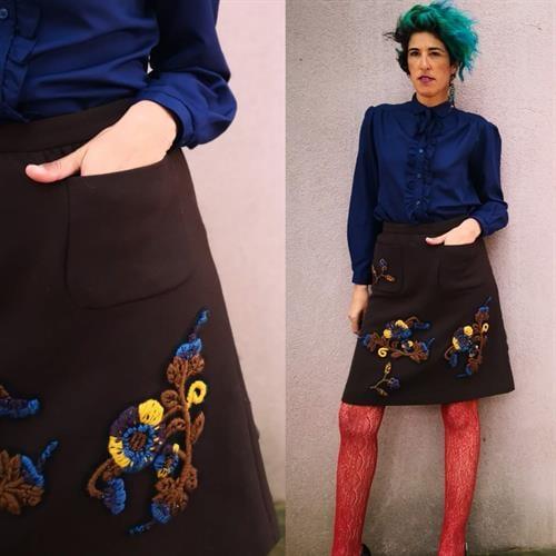 חצאית מיני של מיו מיו גזרה גבוהה מידה M