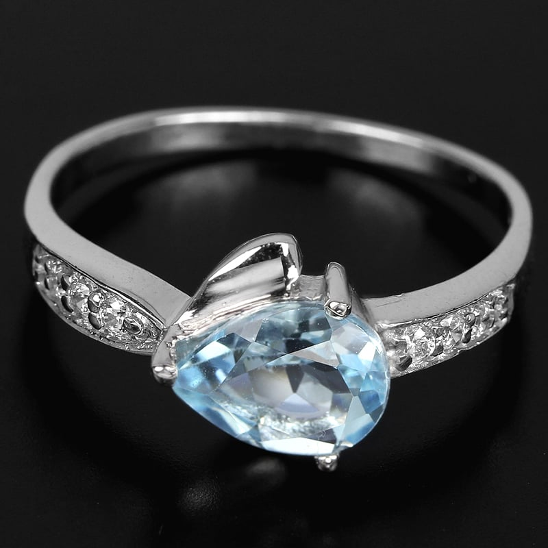 טבעת כסף משובצת טופז כחול וזרקונים RG3431