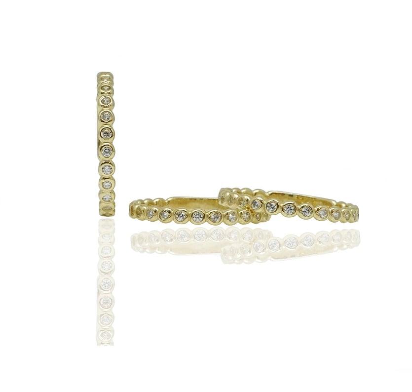 טבעת זהב מידי זרקונים  מעוצבת