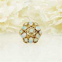 טבעת זהב מיוחדת ומרשימה עם אבני אופל טבעיות
