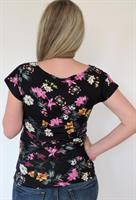 חולצת הריון חצי חצי- גב פרחוני וחזית שחורה בתוספת כיס פרחוני