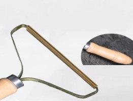 מברשת מקצועית להסרת כדוריות בד מהבגדים