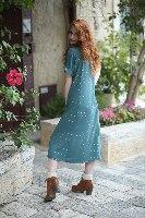 שמלת ג'ינגר ירוקה עם הדפס זהב עדין