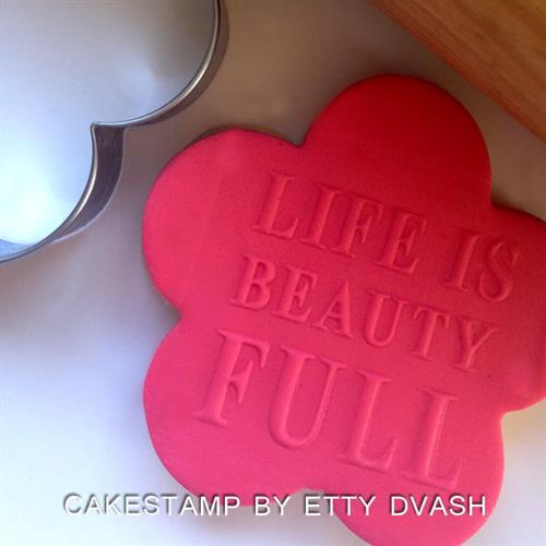 LIFE IS BEAUTIFUL - תבליט