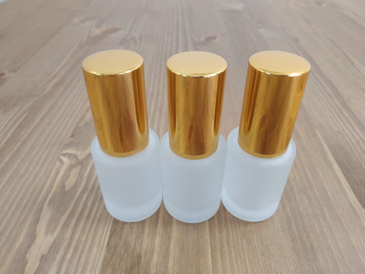 """בקבוק זכוכית 15 מ""""ל  מתז ומכסה בגוון זהב"""