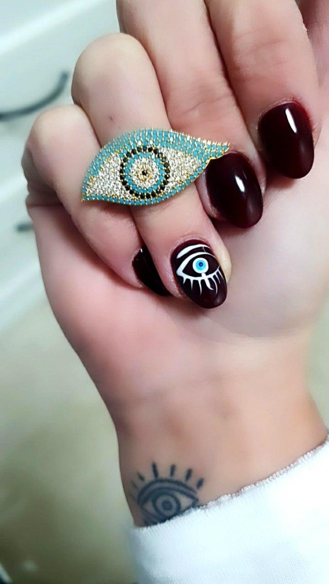 טבעת עין גדולה משובצת