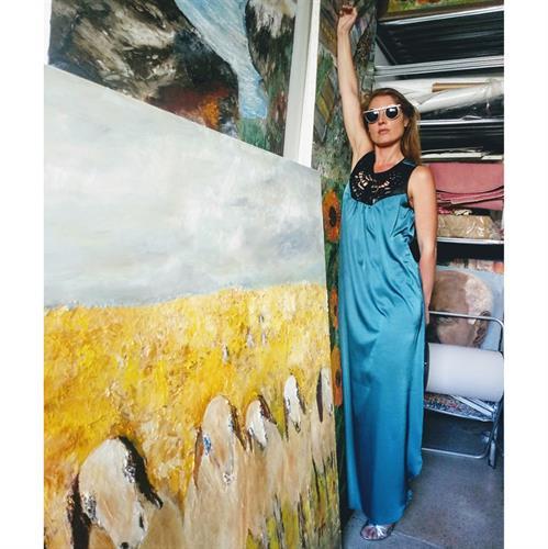 שמלת בל טורקיז שילוב דמויי עור לייזר קאט