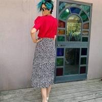 חצאית פליסה אייטיז הדפס שחור/בייג מידה M