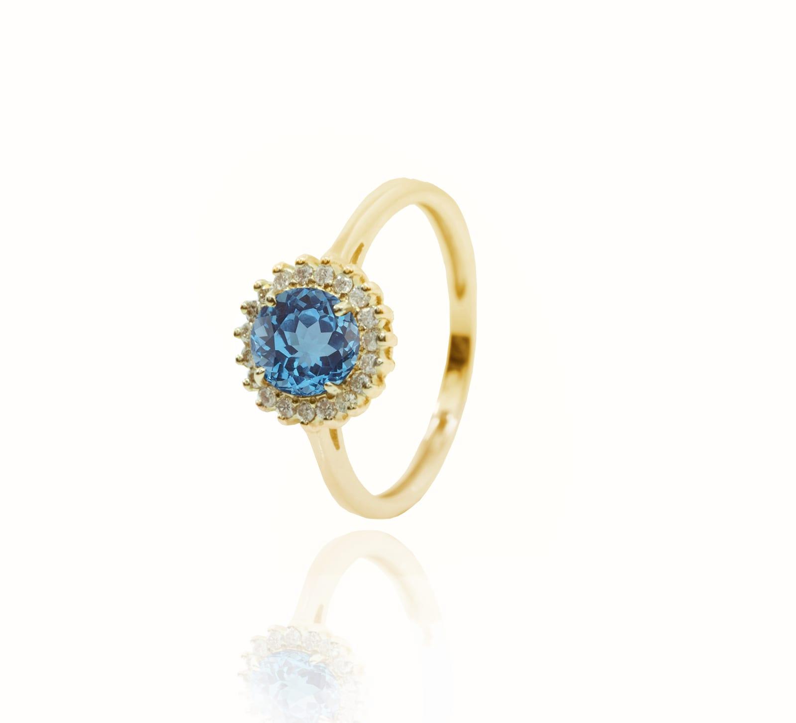 טבעת זהב 14 קרט משובצת אבן חן בלו טופז ו0.15 קראט יהלומים