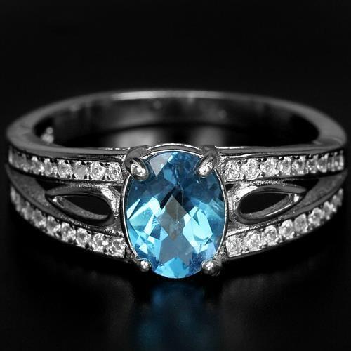 טבעת כסף משובצת טופז כחול RG3101