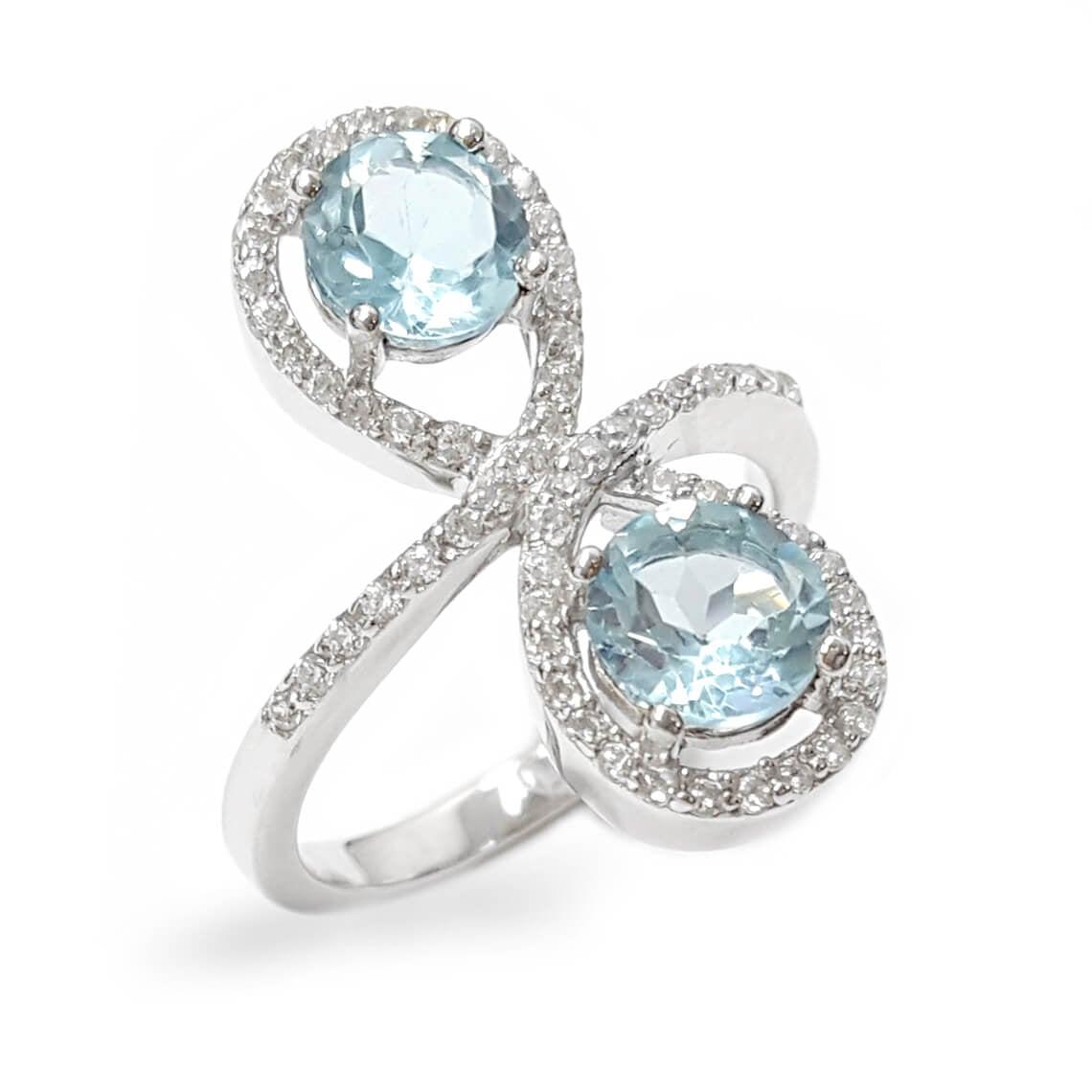טבעת מכסף משובצת 2 אבני טופז כחולות וזרקונים RG1573