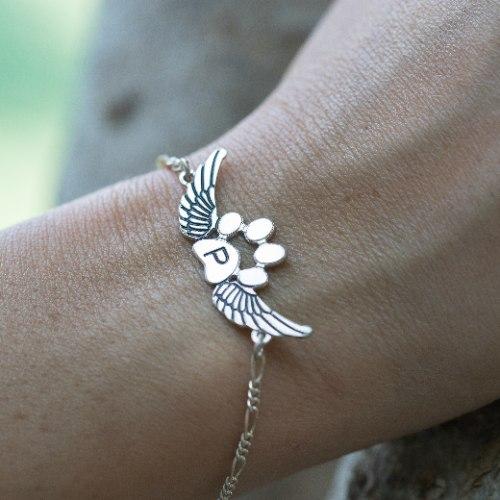 צמיד כנפיים עם כף רגל