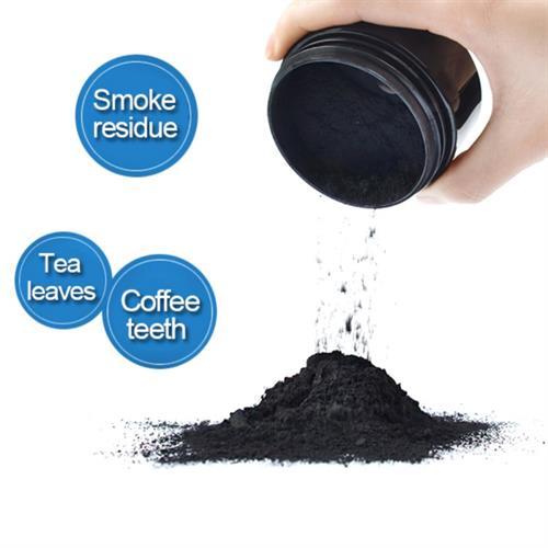 אבקת פחם טבעית להלבנת השיניים
