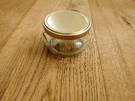 """צנצנת זכוכית מכסה בגוון זהב 218 מ""""ל"""