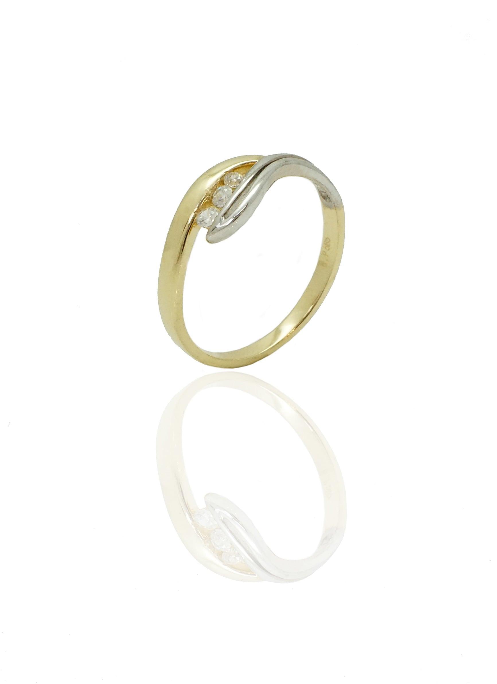 טבעת זהב צהוב ולבן משובצת זרקונים