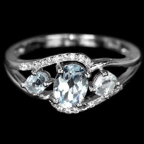 טבעת מכסף  משובצת אבני טופז כחולות וזרקונים RG8414 | תכשיטי כסף 925 | טבעות כסף